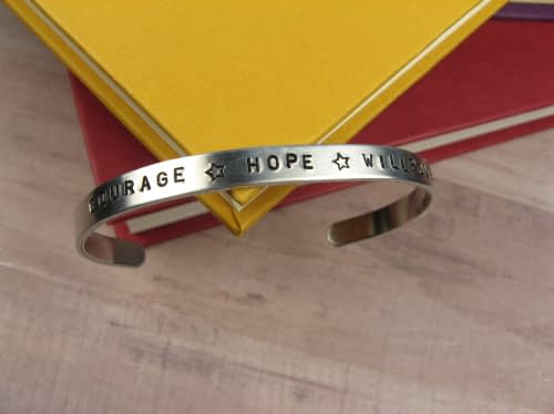 Custom bracelet that says courage, hope, and willpower.