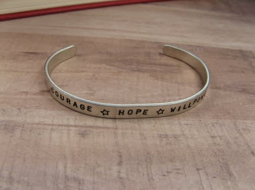 Bracelet that says courage,hope, willpower