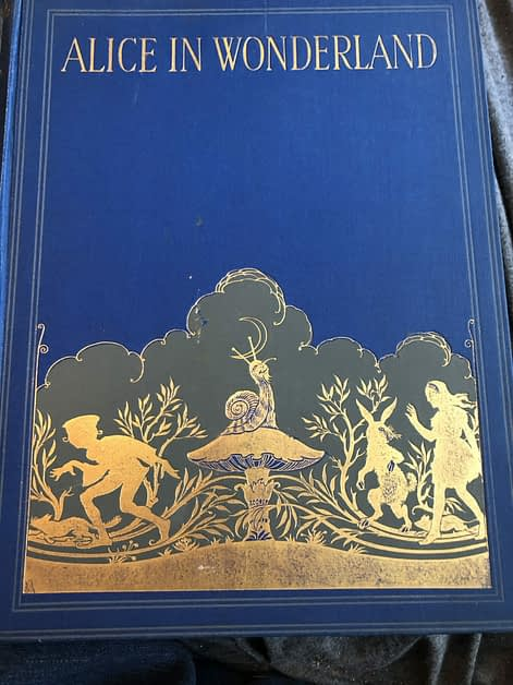 Blue and gold book cover for Alice in Wonderland